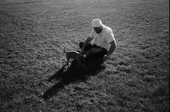A Man and His Dog (ShaneJMrozek) Tags: 35mm film filmisnotdead bnw black white nikon l35af dog boxer