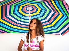 Here Comes The Rain (lothar1908) Tags: 50mm 5dmarkiii baleari bambina canon cecilia colori estate esterno eyes faccia face formentera look portrait pov primopiano ritratto sguardo ombrellone macarons