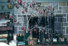 A Sparkly Christmas Tree and a Shiny Fireplace (Alan Mays) Tags: christmas xmas old blue trees decorations red white green vintage silver grey holidays shiny interiors rooms photos gray tools ephemera gifts photographs ornaments tiles presents 1950s kodachrome christmastrees slides sparkly twigs transparencies foundphotos fireplaces december25 redborder fireplacetools twigtrees twigchristmastrees