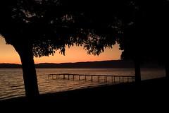 Dimming (petar t) Tags: trees sunset lake tree beach nature water silhouette port landscape europa europe village sundown dusk silhouettes samsung macedonia ohrid balkans balkan gorica  lakescape     ohridlake   photoscape     blinkagain s5260  magicmomentsinyourlifelevel2 magicmomentsinyourlifelevel1 magicmomentsinyourlife