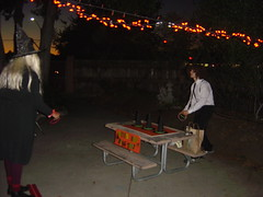 A witch tries Prema's Witch Hat Ring Toss game (Tan Tachyon) Tags: halloween prema afe 2013 alternativefamilyeducation afehalloweenextravaganza