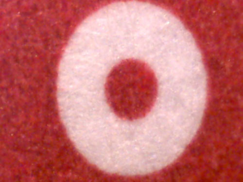 "microscope detail – Uniqlo label • <a style=""font-size:0.8em;"" href=""http://www.flickr.com/photos/61714195@N00/11736764513/"" target=""_blank"">View on Flickr</a>"