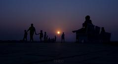sunset happening (lokibo) Tags: travel blue sunset people sun silhouette laos vientiane