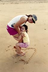 True love (Unbendable Girder) Tags: camera slr film beach nikon fuji superia australia f100 qld queensland fujifilm townsville ingham s100 100iso c41