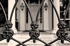 Gate Detail (Erik Pronske) Tags: blackandwhite white black detail sepia louisiana gate unitedstates neworleans uptown mansion tone gardendistrict