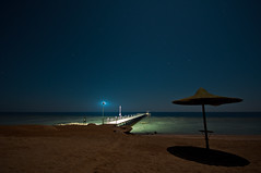 Loneliness /  (Kochum) Tags: light sea beach lamp night stars pier nikon loneliness redsea egypt reef 1020 coralreef  marsaalam   d90  sigma1020