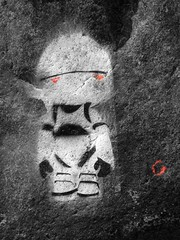 marvin (trismgiste) Tags: light red sun streetart art stone graffiti robot eyes kunst arts paranoid h2g2 freiburg marvin android spraying thehitchhikersguidetothegalaxy selective selectivecolor hhgttg colorkey peranhalterdurchdiegalaxis selectivecoloring vision:outdoor=0971 vision:sky=0581