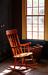 Rocking (Samantha Evans of Samantha Evans Photography) Tags: westville ga georgia lumpkin lumpkinga livinghistorymuseum history architecture architecturaldetail building window windows light sunlight sun canon canon60d tamron1750 wood wooden brown black yellow green line lines pattern patterns decor decorative rug hair glass paint trim bureau ciffarobe handles door doors drawer spindle crib plank floor armrest seat curve