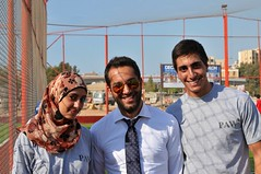 Cast members Layan Rakka and Ali Bazzi with INJAZ volunteer Karam Nasir (center) at a PAW event.