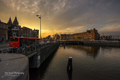 Sunset in Amsterdam (Nur Ismail Photography) Tags: sunset netherlands station amsterdam clouds evening thenetherlands bicycles trainstation publictransport amsterdamcentraal waterway nurismailphotography nurismailmohammed nurismail kelanaconvoy