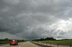 into the rain... (dawn.v) Tags: uk travel summer england sky car june clouds drive nikon stormy dorset ontheroad darkclouds stormclouds rainclouds