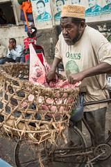 Zanzibar, 02.2016 (bartekdworski) Tags: man face meat market marketplace bike basket zanzibar africa unguja