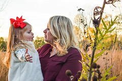 Daughter's Story (TheCozyEscape) Tags: talk listen mother daughter child girl bow mom momanddaughter motheranddaughter fall leaves autumn outdoor nature portrait goldenhour gold green yellow red women woman story telling cute adorable hair trees outdoors beautiful
