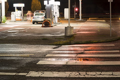 Crosswalk (Curtis Gregory Perry) Tags: oregon oregoncity night 14th main street road avenue wet pavement concrete gas station longexposure dark light nikon d800e