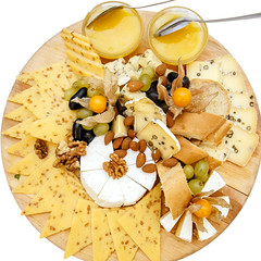 cheese platter with nuts and honey on a plate (Contact: vk.com/Piotr.piatrouski) Tags: plate food snack cheese wooden board parmesan gourmet appetizer grapes rustic meal slice blue white italian honey table delicious piece french brie camembert fruit grape dairy cutting ingredient product smoked soft wine walnut copy yellow delicatessen swiss space roquefort wood dried sliced nut eating delicacy hard gruyere cheeseboard assorted assorti