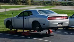 Challenged Challenger (artistmac) Tags: southbend in indiana tirerack tires wheels dodge challenger nowheels floorjacks silver parkinglot haha discbrakers rotors calipers naked car ponycar sportycar mopar chrysler outdoor