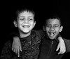 Friendship (mark.aizenberg) Tags: child children people blackandwhite groupshot monochrome black background smile happy happiness friends boys kids indoor studio portrait portraiture headshot eyes