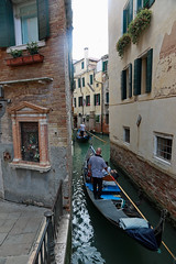 Venice, canal & street shrine, (Madonna de Carmine) (Kurtsview) Tags: italy venice street shrine people gondola gondolier canal water boat outdoor