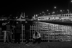 They say the lights are always bright on... / the life we live (zgr Grgey) Tags: 2016 35mm bw d750 darkcity genesis karaky nikon samyang architecture candid evening lights lowlight street istanbul turkey