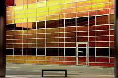 Farbenspiel VI (Mastahkid) Tags: mastahkid almere nederland niederlande thenetherlands fassade facade bank tr door fenster windows gelb yellow rot red metall metal glas beton gebude building ontouewithmyego