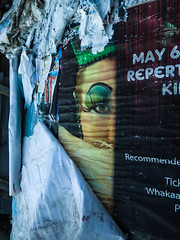 Who Wears the Crown? (Steve Taylor (Photography)) Tags: queen crown peelingoff ripped torn covered weathered may6 recommended tickets repertory disintergrating art advert poster black blue green paper newzealand nz southisland canterbury christchurch cbd city distorted half face makeup eyebrow eyelash eyeshadow whowearsthecrown