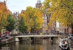 De Geldersekade, Amsterdam Netherlands (PhotosToArtByMike) Tags: amsterdam geldersekade centrum centercity netherlands dutch holland canalhouse bikes canal bridge