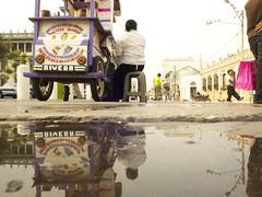 heladera (maybemaq) Tags: street city holiday reflection rain wheel shop kids mirror avenida calle back kid lluvia flo