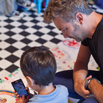 Our Illustrator in Residence Barroux helps a youngster get involved with his Big Draw