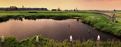 Schokland lost its status as an island when it was reclaimed from the sea in 1942 (Bn) Tags: world old light sunset sea summer lighthouse haven holland green heritage history water netherlands dutch grass marina