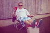 Fool's Paradise..... (JLC Photography Spokane,WA) Tags: selfportrait man male men guy america photoshop canon 50mm backyard spokane paradise artistic garage creative photoaday cooler 365 conceptual redwhiteandblue ghetto fool denile fallingapart ignoranceisbliss beachwear foolsparadise avoiding foldupchair redsolocup noparadise