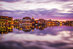 Portsmouth Waterfront (Robert Clifford) Tags: ocean longexposure bridge sunset sky reflection night clouds buildings river cloudy newengland newhampshire calm portsmouth coastline memorialbridge piscataqua cliffordphotography robertallanclifford cliffordphotographynhcom