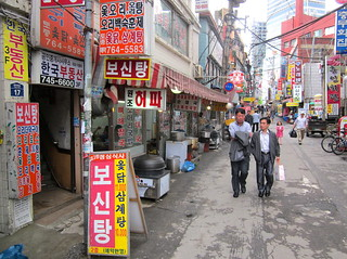 Seoul Korea Dongdaemun market area streetview - busy backalley with dog soup restaurant open for lunch -