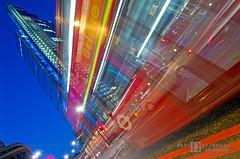 London Buzz (davidgutierrez.co.uk) Tags: city uk blue light red sky urban lightpainting motion blur bus london tower art heron colors architecture night skyscraper buzz photography space transport perspective engineering londres lighttrails bluehour buzzing  londyn    streaminglights davidgutierrez pentaxk5 londonbuzz