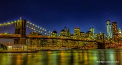Brooklyn Bridge_NYC (ImagesByRayD) Tags: city nyc bridge color night lights downtown cityscape waterfront manhattan citylife carousel brooklynbridge wtc waterway brooklynbridgepark nycpark canon5dmarkiii rkdashphotosyahoocom