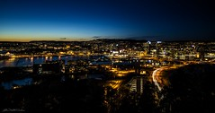 Oslo City By Night (Lillian Molstad Andresen) Tags: city trees sunset sky streets cars water oslo norway architecture night marina truck buildings reflections landscape boats hotel evening cityscape hills fjord oslooperahouse holmenkollenskujump