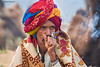 Smoking Man (Irene Becker) Tags: morning portrait india animals rural countryside desert outdoor sale cigarette smoke traditional smoking camel marketplace turban pushkar rajasthan imagesofindia pushkarcamelfair incredibleindia indianimages annualevent pushkarcattlefair livestockfair animalsforsale pushkarkamela animalsfortrading irenebeckereu