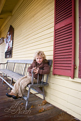 Casually sitting outside the Old Country Store (grilljam) Tags: newhampshire ewan countrystore 4yrs