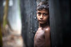 A child in Dhaka's Karial slum, Bangladesh (unescap) Tags: boy child dhaka bangladesh nutrition underweight