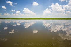 Chobe River ([[BIOSPHERE]]) Tags: sky reflection clouds botswana choberiver chobenationalpark