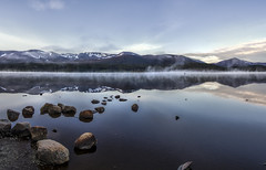 Early Morning at Loch Morlich (HDR Panorama) (plume-rider) Tags: mist snow mountains reflection water photoshop scotland calm aviemore hdr topaz lochmorlich photomatix