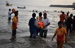 Ganapati Visarjan (Mayur Kakade) Tags: evening hill malabar skyline seashore landscape girgaum chaupati chowpatty girgaon sea idol pilgrims indians india maharashtra mumbai ritual religion hindu hinduism ganesh immersion visarjan ganapati outdoor