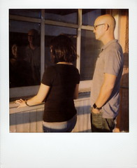 Synthia & Justin (tobysx70) Tags: the impossible project tip polaroid slr680 frankenroid sx70 door rollers film for 600 type cameras instant impossaroid roidweek roid week polaroidweek fall autumn october 2016 synthia and justin norman roscoe evers hardware building west hickory street denton texas tx couple portrait golden hour window reflection polacon2016 polaconone 100116 day5 toby hancock photography