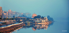 The dawn of Mansoura (hosamir) Tags: dawn nile photography photoshot mosque mansoura travel architectural architecture landscape outdoor morning africa rest street city center blue sky