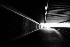 Tunnel Vision (Dan-Schneider) Tags: streetphotography silhouette light lines schwarzweiss blackandwhite bw olympus omdem10 monochrome human dark tunnel subway