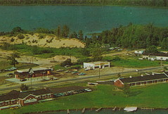 """NW Elk Rapids Kewadin MI c.1970s View of THE ELK RIVER INN BEFORE THE FIRE DISASTER & both Elk Lake & Birch Lake looking due North US-31 & THE BRIDGE on Antrim Countys CHAIN OF LAKES3 (UpNorth Memories - Donald (Don) Harrison) Tags: vintage antique postcard rppc """"don harrison"""" """"upnorth memories"""" upnorth memories upnorthmemories michigan history heritage travel tourism """"michigan roadside restaurants cafes motels hotels """"tourist stops"""" """"travel trailer parks"""" campgrounds cottages cabins """"roadside entertainment"""" """"natural wonders"""" attractions usa puremichigan """" """"railroad ferry"""" """"car excursion"""
