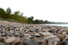 Beach Rocks (mraarondouglas) Tags: beach beaches sand water waterfront waves boardwalk weed green leav leaves plant rocks angle angles ground level lake michigan great lakes pier lighthouse red kenosha racine wi wisconsin il illinois chicago milwaukee photography photo photograph image canon rebel t5 1200d canon1585