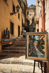 Backstreets of Taormina, Sicily [Explored] (Holfo) Tags: italy sicily taormina painting backstreet nikon d5300 street art shop shopping mediterranean artwork steps lantern