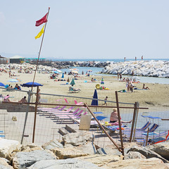 Hectic busy and colorful scene on an Italian beach (Marco Venturini Autieri) Tags: sea summer sky people italy colour beach water season photography coast colorful europe deckchair candid flag traditional horizon pisa boulders busy shore squareformat tuscany messy local typical multicolored boundary uncomfortable constructionsite confusion livorno traditionalculture hectic outofcontext leghorn ombrellone marinadipisa traditionallyitalian mediterraneancountries safetysignal bagnanti constructionmaterial sedieasdraio imagecreated21stcentury lovelocal locationsandtravel horizonoversea portodipisa
