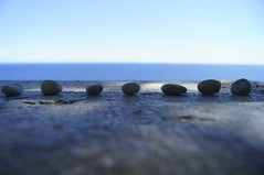 Order. (A not very creative mind) Tags: blue sea sky macro focus order stones horizon symmetry