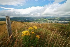 Derbyshire Hills (Missy Jussy) Tags: flowers england sky sunlight grass rain clouds canon fence landscape town northwest wind derbyshire hills views